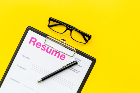 Photo for Looking for work concept. Resume on pad near pen and glasses on yellow background top view. - Royalty Free Image