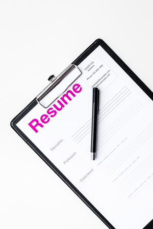 Photo for Looking for work concept. Resume on pad with on white background top view. - Royalty Free Image