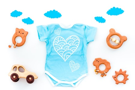 Foto für Newborn baby's sleep concept. To put the child to bed. Baby bodysuit near clouds and baby accessories on white background top view copy space - Lizenzfreies Bild