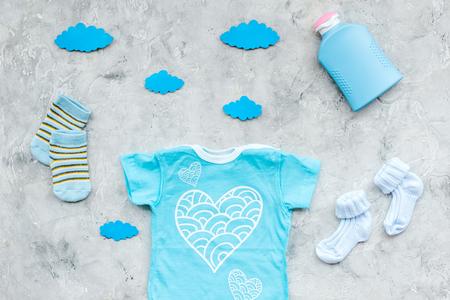 Foto für Baby shower concept. Babys clothes and accessories on grey background top view - Lizenzfreies Bild