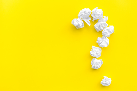 Foto de Question mark lined with crumpled paper on yellow background top view. - Imagen libre de derechos