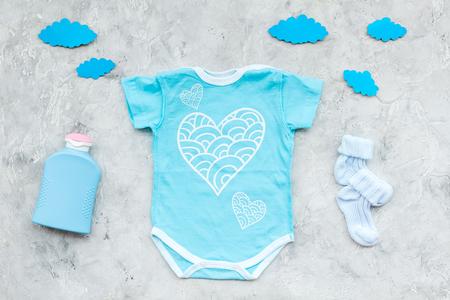 Foto für Baby shower concept. Baby's clothes and accessories on grey background top view - Lizenzfreies Bild