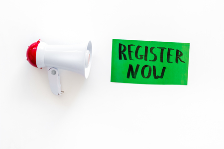Photo for Register now hand lettering icon near megaphone on white background top view. - Royalty Free Image