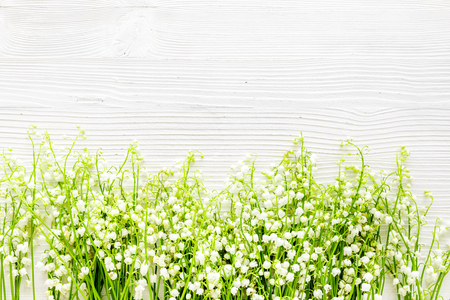 Photo pour Lily of the valley flowers frame. Spring background on white desk top view copy space - image libre de droit