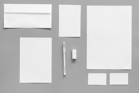 Foto de Mockup template for branding identity. White stationery on grey background top view. Pattern - Imagen libre de derechos