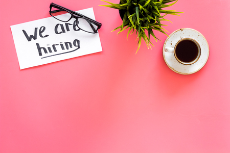 Photo for Search for worker, employee concept. We are hiring lettering on work desk on pink background top view. - Royalty Free Image