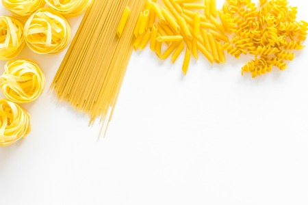 Photo for Set of pasta. Raw spaghetti, fusilli, penne, fettuccine on white background top view. - Royalty Free Image