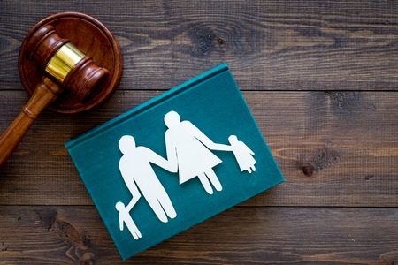 Photo for Family law, family right concept. Child-custody concept. Family with children cutout near court gavel on dark wooden background top view copy space - Royalty Free Image