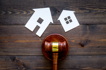 Photo for House cutout near judge gavel on dark wooden background top view copy space. Housing law. Property division. Real estate auction - Royalty Free Image