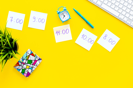 Photo for Students schedule. Notepaper with time of lessons on yellow office desk with computer keyboard top view copy space - Royalty Free Image