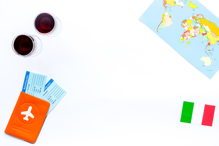 Photo for Gastronomical tourism. Italian food symbols. Passport and tickets near italian flag, glass of red wine, map of the world on white background top view copy space border - Royalty Free Image