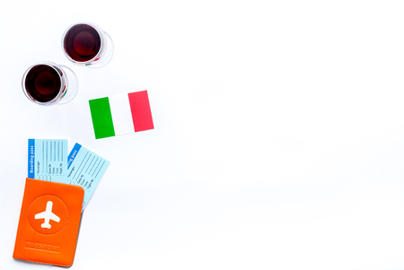Photo for Gastronomical tourism. Italian food symbols. Passport and tickets near Italian flag and glass of red wine on white background top view copy space - Royalty Free Image