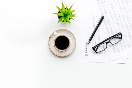 Foto de Business lunch with pencil, document and black coffee on work desk on white background top view mock up - Imagen libre de derechos