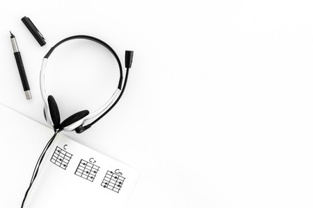 Photo for Desk of musician for songwriter work with headphones and notes on white background top view mockup - Royalty Free Image