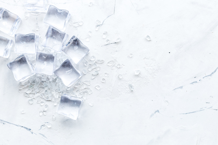 Foto de Frozen water in ice cubes on marble bar table top view mockup - Imagen libre de derechos