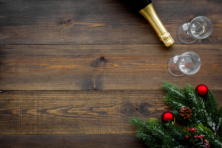 Foto de Spruce, champagne bottle and glasses for christmas celebration on wooden table - Imagen libre de derechos