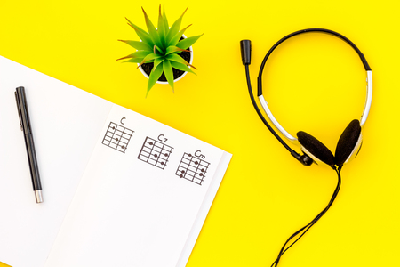 Photo for Headphone with paper note in music studio for dj or musician work yellow background top view space for text - Royalty Free Image