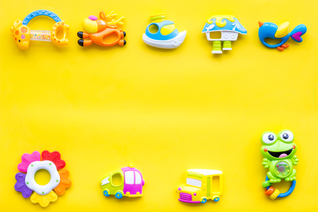 Photo pour Craft toys for kids. Developing rattle for the smallest. Yellow background top view mock up - image libre de droit