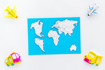 Photo pour Children tourism outfit with map and toys white background flat lay - image libre de droit