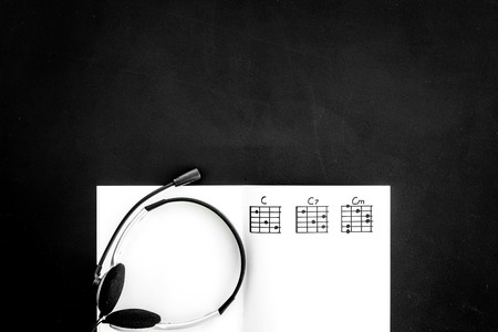 Photo for Headphone with paper note in music studio for dj or musician work black background top view space for text - Royalty Free Image