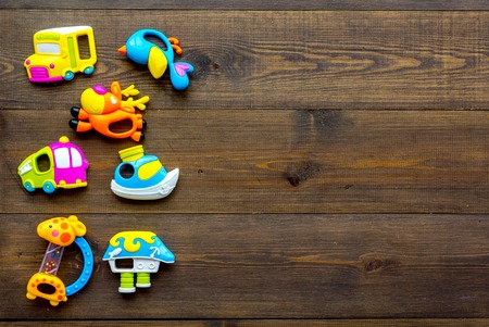 Photo pour Craft toys for kids. Developing rattle for the smallest. Wooden background top view mock up - image libre de droit