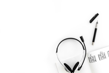 Photo for Desk of musician for songwriter work with headphones and notes white background top view mockup - Royalty Free Image