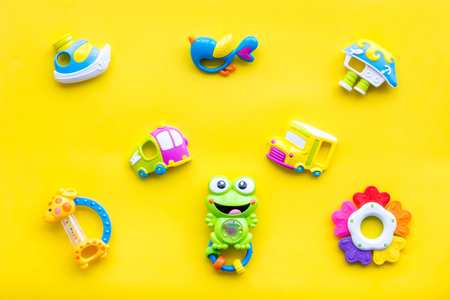 Photo pour Craft toys for kids. Developing rattle for the smallest. Yellow background top view - image libre de droit