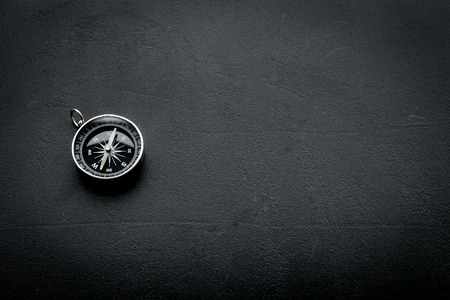 Photo pour Direction concept with compass on black background top view space for text - image libre de droit