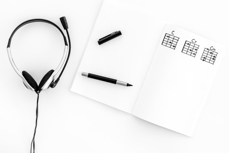 Photo for Songwriter or dj work place with notes and headphones on white background top view mock up - Royalty Free Image