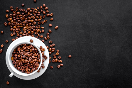 Foto de Coffee concept. Roasted beans on black background top view copy space. - Imagen libre de derechos