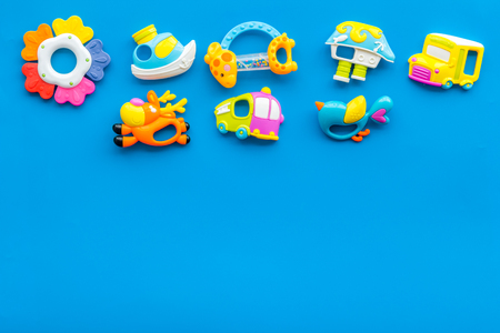Photo pour Craft toys for kids. Developing rattle for the smallest. Blue desk background top view mock up - image libre de droit