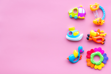 Photo pour Craft toys for kids. Developing rattle for the smallest. Pink background top view mock up - image libre de droit