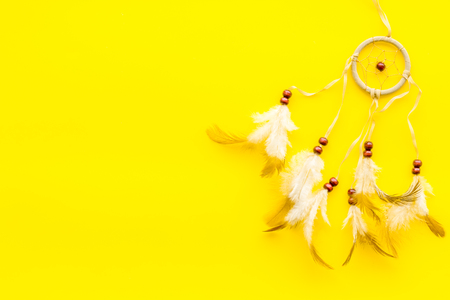 Photo for Asian attributes. Dream catcher on yellow background top view copy space - Royalty Free Image