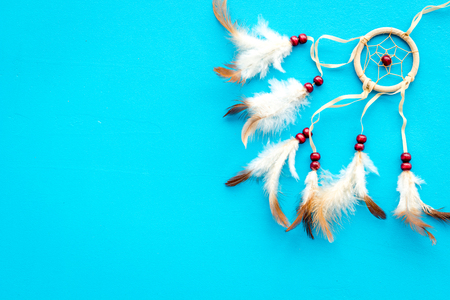 Photo for Asian attributes. Dream catcher on blue background top view space for text - Royalty Free Image
