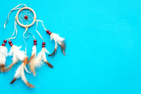 Photo for Asian attributes. Dream catcher on blue background top view. - Royalty Free Image