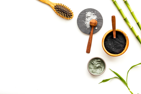 Photo for Skin cleansing and detox. Bamboo charcoal powder cosmetics on white background top view copy space - Royalty Free Image