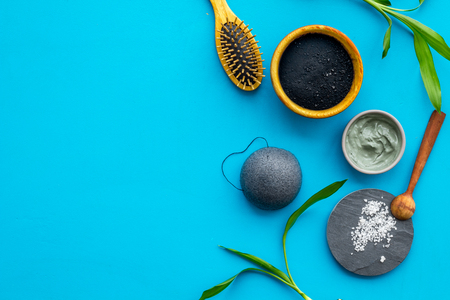 Photo for Hair care, hair spa. Cosmetics based on bamboo charcoal powder near comb on blue background top view space for text - Royalty Free Image