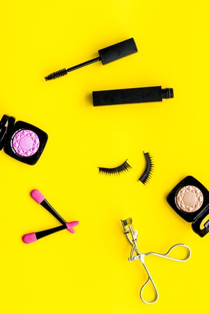 Photo pour Female desk with decorative organic cosmetic on yellow background flatlay - image libre de droit