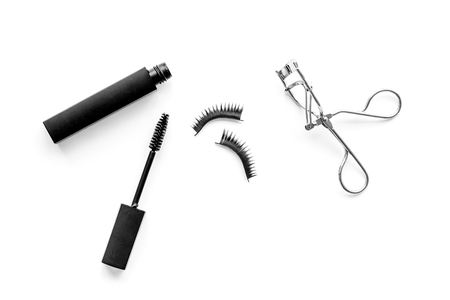 Photo pour Organic decorative cosmetic set with lash curler and mascara on white woman desk background top view. - image libre de droit