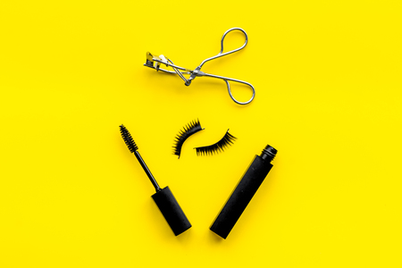 Photo pour Female desk with decorative cosmetic for make up on yellow background top view - image libre de droit