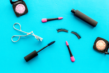 Photo pour Female desk with decorative organic cosmetic on blue background flatlay - image libre de droit