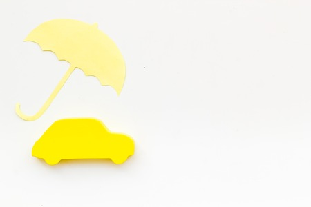 Photo pour Buying car. Car insurance concept with car and umbrella toys on white background top view mockup - image libre de droit