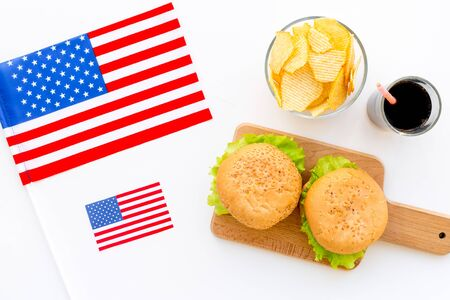 Photo for Flag USA and national food, burgers, chips on white background top view - Royalty Free Image