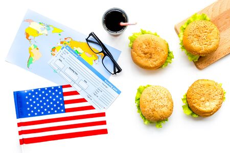 Photo for Travel for traditional USA cuisine with burgers, passport, tickets, flag and map white background top view - Royalty Free Image