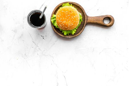 Photo for USA cuisine. Burger and drink for national american kitchen concept on marble background top view mock up - Royalty Free Image