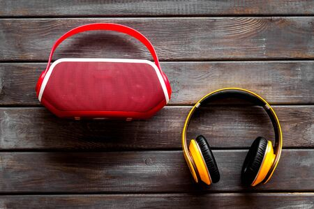 Photo for Wireless headphones and portable speaker on wooden background top view - Royalty Free Image