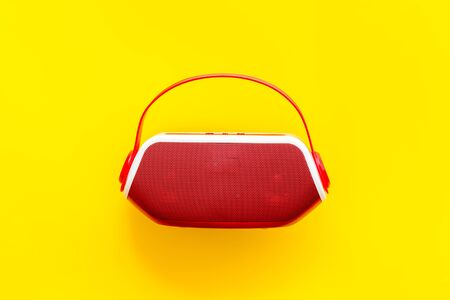 Photo for Wireless speaker as music gadgets on yellow background top view - Royalty Free Image