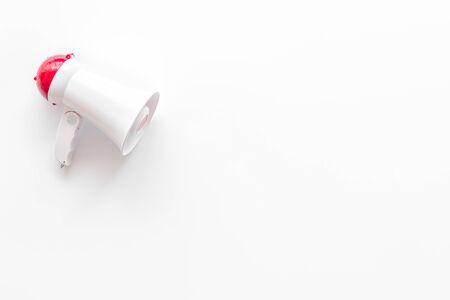Photo pour Announcement with megaphone on white background top view mock up - image libre de droit