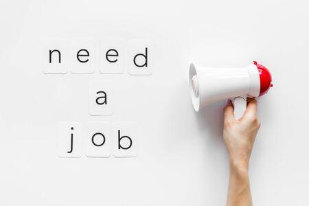 Photo pour Need a job announcement symbol with megaphone and text on white background top view - image libre de droit