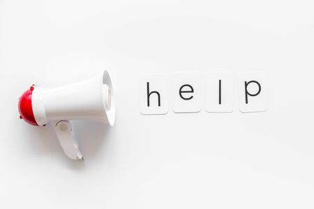 Photo pour Announcement for a help with megaphone and text on white background top view - image libre de droit